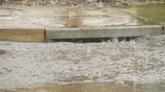 Rainwater pours into drainage system Stock Footage