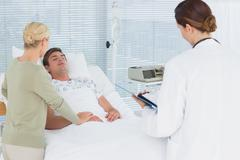 Stock Photo of Doctors taking care of patient