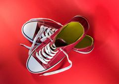 Stock Photo of Pair of Scarlet Canvas Trainers and White Laces