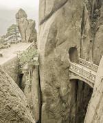 Mountain stone bridge above rocky precipice between the rock Stock Photos