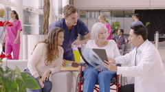 4K Caring medical staff in modern hospital discuss x-ray results with a patient Stock Footage