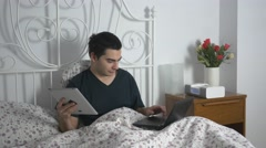 4K Tablet and Computer Being Used In Bed Stock Footage