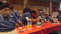 Children taking part in a biology exhibit at a science fair. Stock Footage