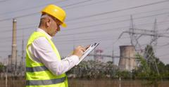 Engineer Man Verify Clipboard Calculation Note Electrical Energy Infrastructure - stock footage