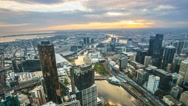 Stock Video Footage of Aerial View Of Melbourne Cityscape During Sunset. Timelapse, Zoom In