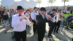The brass band musicians perform in a city park. Stock Footage