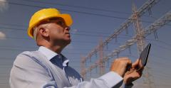 Technician Checking Electrical High Voltage System Parameters Energy Industry - stock footage