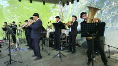 Brass Band performing on the stage in the park. Stock Footage