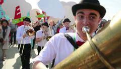 The brass band musicians perform in a city park. - stock footage