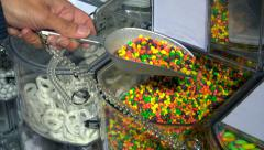 Buyer selects the beans candy in the store. Stock Footage