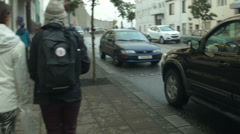 Young Woman walks down the street in REYKJAVIK, ICELAND Stock Footage