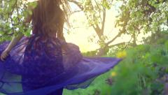 Stock Video Footage of Beauty girl in blowing long transparent chiffon dress.  Enjoying nature outdoor