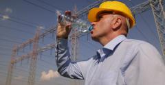 Torrid Day Electrician Drink Water Hot Summer High Voltage Electricity Industry Stock Footage