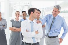 Stock Photo of Businessman congratulating his colleagues