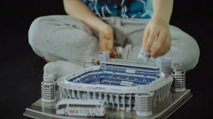 Stock Video Footage of child collects toy sport Stadium close shot