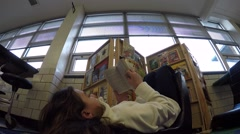 A student reading a chapter book - stock footage
