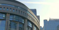 The European Union EU Parliament EP Euro Europe Brussels buildings pan tilt up Stock Footage