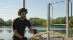 Man doing Rope excerise Stock Footage