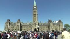Large group on Canada's Parliament Hill singing national anthem - 'O' Canada - stock footage