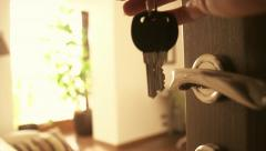 Woman's hand open a door of comfortable apartments and enter inside. Keys - stock footage