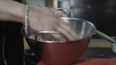 Cook mixing forcemeat in a metal aluminium bowl Stock Footage