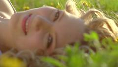 Beautiful spring young woman outdoors enjoying nature. Healthy girl - stock footage
