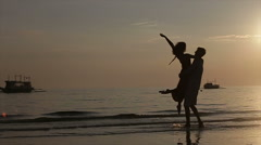 Lovers at sunset - stock footage