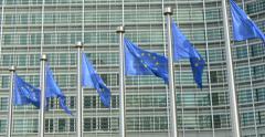 European Union EU Europe Europa euro flag flags waving wavy windy blue Brussels Stock Footage