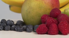 Arrangement of Fruits Lemon Banana Blueberry Grape Raspberry Mango Stock Footage