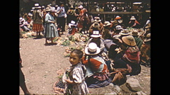 Vintage 16mm film, 1960, village life, local Peruvians gathered Stock Footage