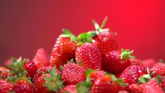 Fresh ripe perfect strawberry over red background. Food concept Stock Footage
