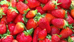 Fresh ripe perfect strawberry. Food frame background - stock footage
