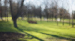 Blurred bokeh background in city park spring time, 50mm lens prores hq footage Stock Footage