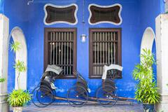 Stock Photo of Old rickshaw tricycle near Fatt Tze Mansion or Blue Mansion, Penang