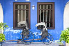 Old rickshaw tricycle near Fatt Tze Mansion or Blue Mansion, Penang - stock photo