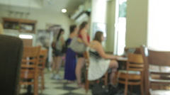 Customers studying in a coffee shop. Young people student Stock Footage