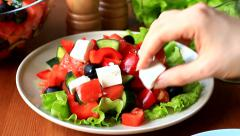 Cooking greek salad with feta cheese - stock footage