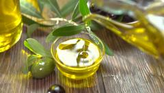 Pouring olive oil and olives. Extra virgin olive oil pouring from the bottle Stock Footage