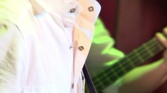 Playing the guitar. The bass and rhythm guitar Stock Footage