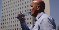 Hot Summer Sweat Salesman Hydrate Drinking Water Office Building Street View Stock Footage