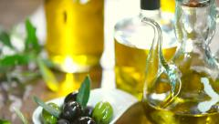 Olives and olive oil on the table - stock footage