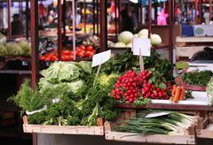Fresh organic vegetables in wooden crates on market stall Stock Photos