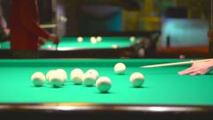 Men playing billiards - young man lining to ball on professional billiard table Stock Footage