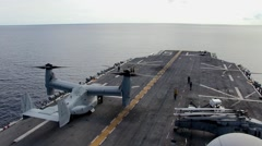 Harrier and helicopter operations off the flight deck of the USS Peleliu (LHA-5) Stock Footage