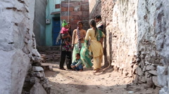 View of women in traditional clothing standing in street. Stock Footage