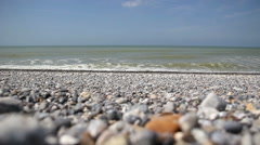 Sea view on pebbles beach Stock Footage