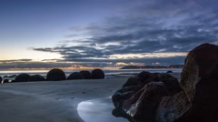 Beautiful Sunrise At Moeraki Boulders- Timelapse Pan Right. Stock Footage