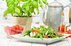Stock Photo of seasonal salad on the old white table