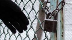 Open padlock key Stock Footage