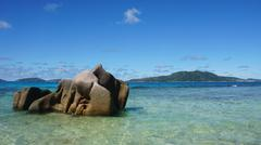 bizarre granite rocks on la digue island - stock photo